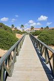 Wooden walkway on sandy beach in Spain royalty free stock image