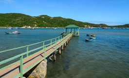 Wooden walkway into the sea royalty free stock photo