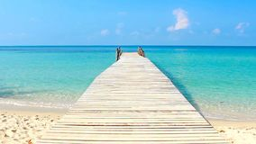 Wooden walkway in the sea on tropical beach Thailand.  stock footage