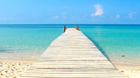 Wooden walkway in the sea on tropical beach thailand.  stock video footage