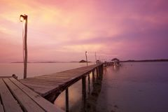 Wooden walkway and sunset. Background Stock Photos