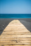 Wooden walkway to the aegean sea Stock Images