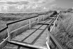 Wooden walkway to the beach Royalty Free Stock Photo