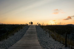 Wooden walkway to beach at sunset Royalty Free Stock Photography
