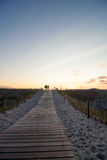 Wooden walkway to beach at sunset Stock Photos