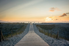 Wooden walkway to beach at sunset Stock Images