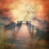 Wooden walkway to misty mountains Royalty Free Stock Photos