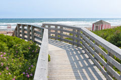 Wooden walkway to ocean beach Stock Photo