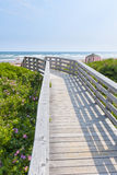 Wooden walkway to ocean beach Stock Photos