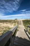 Wooden walkway, Uruguayan eco-lake Garzon. Wooden walkway across the beach on the Uruguayan eco-lake Garzon, Jose Ignacio, Uruguay Stock Image