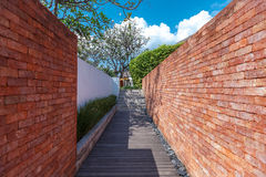 Wooden walkway between the wall Royalty Free Stock Images