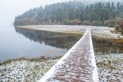 Wooden walkway in winter Stock Image