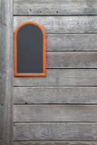 Wooden wall. With a small blackboard Stock Photo