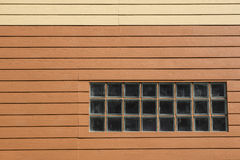 Wooden wall. Orange and cream-colored Wooden wall Stock Images
