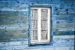 Wooden wall. Rural much neglected window in wooden wall of house, wooden background Stock Photos