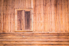 Wooden wall of ancient house with window closed Stock Images