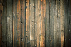 Wooden wall background. Old grungy wooden wall background with nails and nuts Royalty Free Stock Images