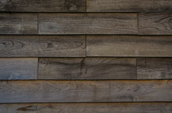 Wooden Wall. A background, of a wooden wall, clearly showing the individual planks of wood and the grain Royalty Free Stock Photography