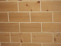 Wooden wall background. Background of a wall made of wood having brick like rectangles Stock Photography