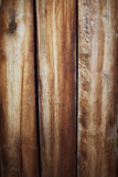 Wooden wall background or texture. Old brown boards Stock Photos