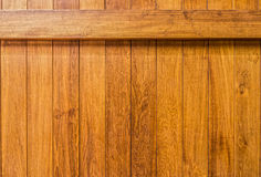 Wooden wall with beam constructed from teak wood lumber planks Royalty Free Stock Images