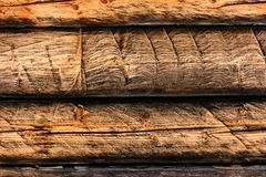 Wooden wall of beams of gray-brown color, texture royalty free stock photo