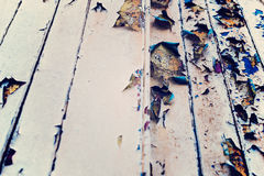 Wooden wall with beige paint, severely weathered and peeling Stock Image