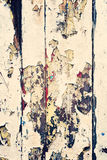Wooden wall with beige paint, severely weathered and peeling Royalty Free Stock Photography