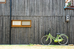 Wooden wall with a bicycle. Black wooden wall with a bicycle Stock Image