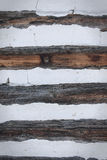 Wooden wall. Brown wooden wall with white plaster Stock Images