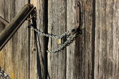 Wooden wall and chain lock Stock Photos