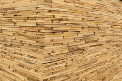 Wooden wall. Corner of the wooden wall made of planks Stock Photography