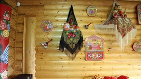 Wooden wall decorated in Russian style. Matryoshka shawls, wooden products stock footage