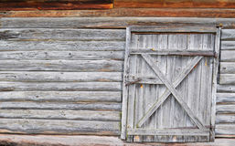 Wooden wall with a door Stock Images