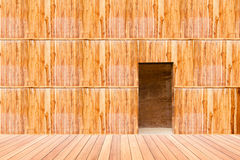 Wooden wall with door and wood floor in front off Royalty Free Stock Photography