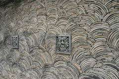 Wooden wall. With dragon head stone Royalty Free Stock Photography