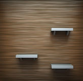 Wooden wall with a few shelves on it. 3d Stock Images