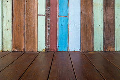 Wooden wall and floor. Wooden old wall pattern with random color painting and wood floor background Royalty Free Stock Image