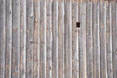 Wooden wall with hole Stock Photography