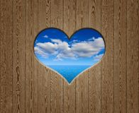 Wooden wall with hole like a heart Royalty Free Stock Image
