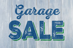 Wooden wall with the inscription Garage Sale. Blue wooden wall with the inscription Garage Sale Stock Photos
