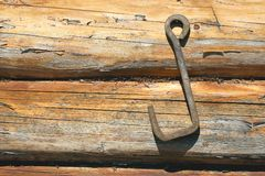 Wooden wall with an iron hook Stock Images