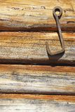 Wooden wall with an iron hook Stock Photo