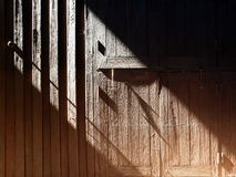 Wooden wall, light and shadow Royalty Free Stock Images