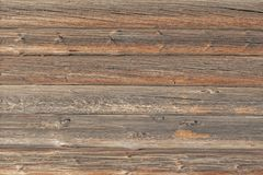 The wooden wall of the log house stock photos