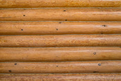 Wooden wall of a log house. Log Cabin Or Barn Unpainted Debarked Wall Textured Horizontal Background With Copy Space.  Stock Image