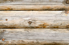 Wooden wall of a loghouse as a background Stock Photo