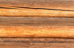 Wooden wall from logs as a background texture royalty free stock images