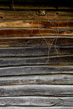 Wooden wall from logs as a background texture Royalty Free Stock Photos