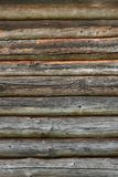 Wooden wall from logs old as background texture Stock Images